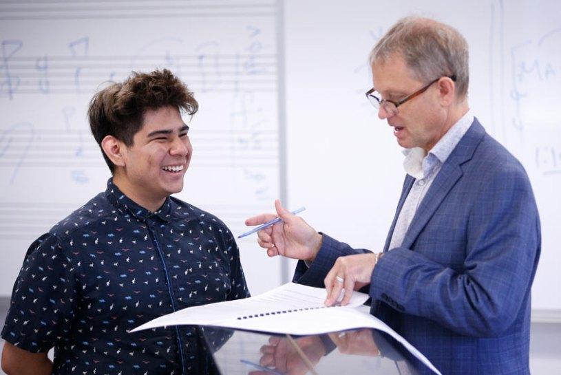 Music student Chris Carreon and Professor Benjamin Boone