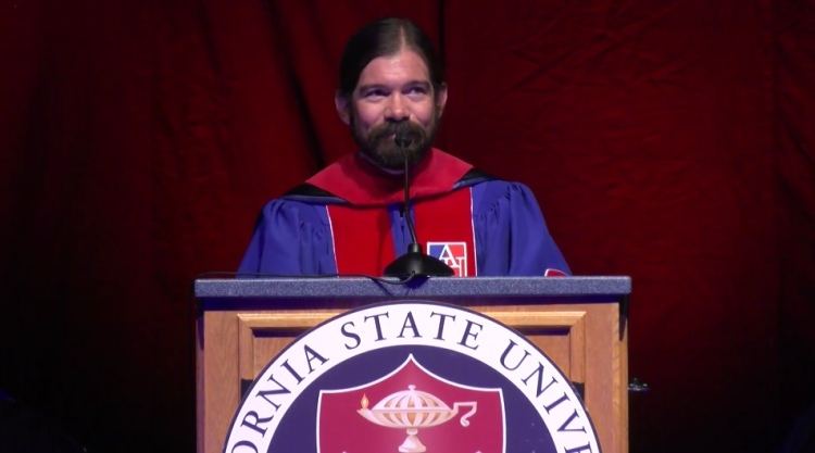 Screenshot of MCJ Professor Jes Therkelsen giving keynote speech about curiosity at New Student Convocation