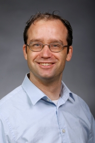 Headshot of Dr. Brian Cozen, assistant professor of communication