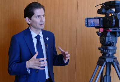 Dean Saúl Jiménez-Sandoval gives a statement to Univision reporter Libertad Pedraza following the press conference on the decision to end the DACA program.