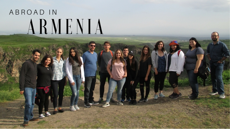 """Abroad in Armenia"" - The students pose for a photo in the green, scenic hills of Armenia."