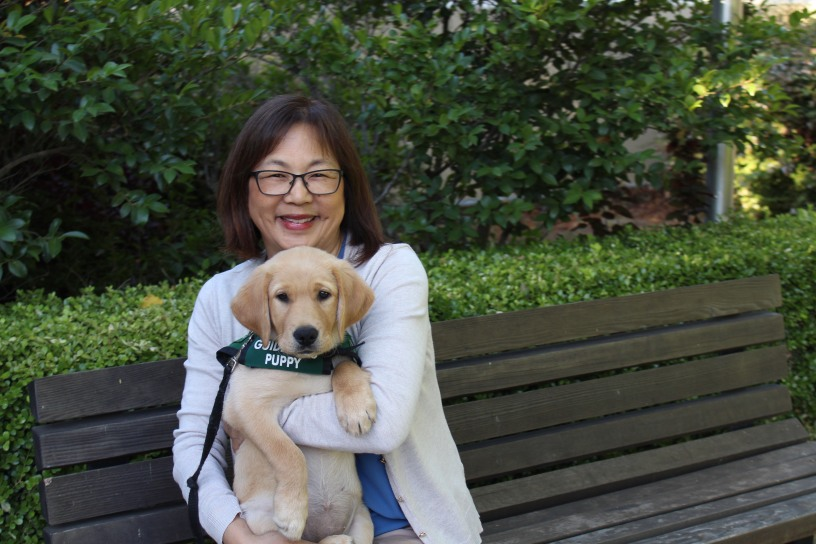 Carol Sera and her guide-dog-in-training Debra
