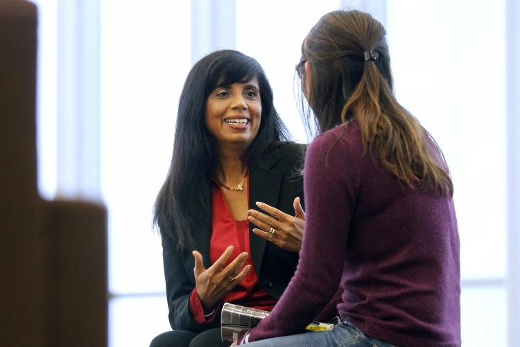 Professor Veena Howard talks with a student.