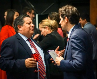 Dean Saúl Jiménez-Sandoval (right) talks with Peter Robertson of the Alumni Association