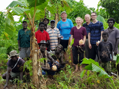 Dr. Jason Brown (third from right) and his team, a group of Naasioi elders and community members on an ethnobiological expedition in Bougainville, collect photographs and record the Naasioi names of plants and animals.