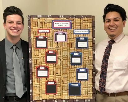 Christopher Rodriguez and Christian Cabral with the competition score board.