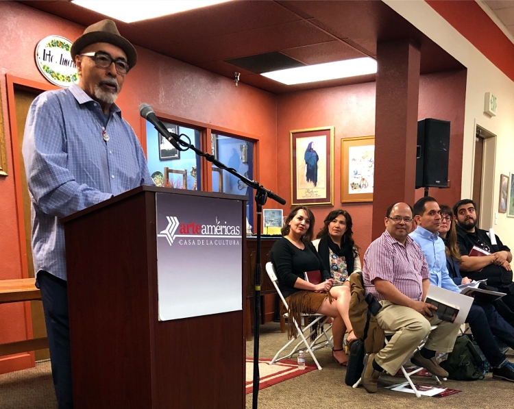 "Juan Felipe Herrera speaks at a national poetry symposium, ""Together We'll Be a Song: A Celebration of Andrés Montoya."""