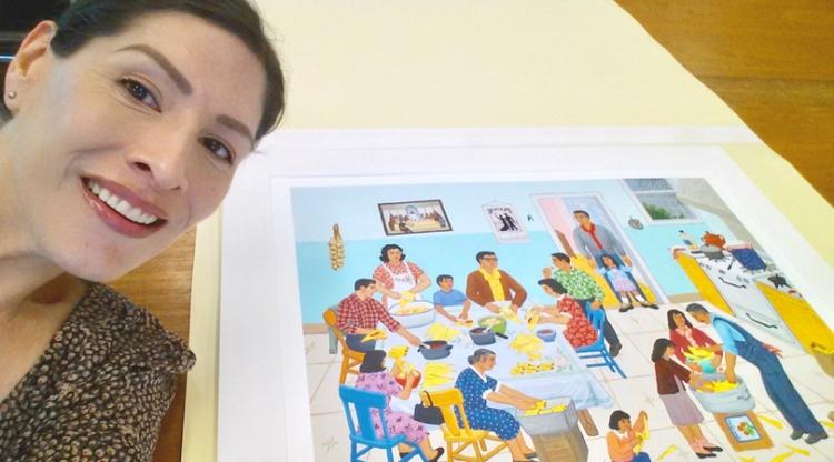 "Dr. Melanie Hernandez with an original print of Carmen Lomas Garza's lithograph ""Tamalada"""