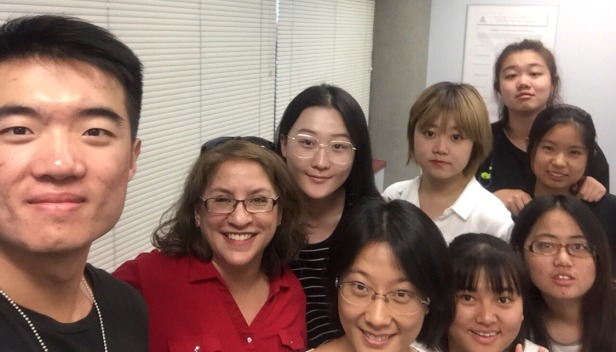 Beijing Union University students pose with Fresno State's Dr. Kelly McCoy
