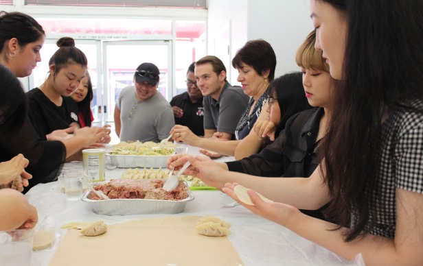 Beijing Union University students and Fresno State faculty and staff work together to make a festive farewell lunch on Wednesday, August 8th.