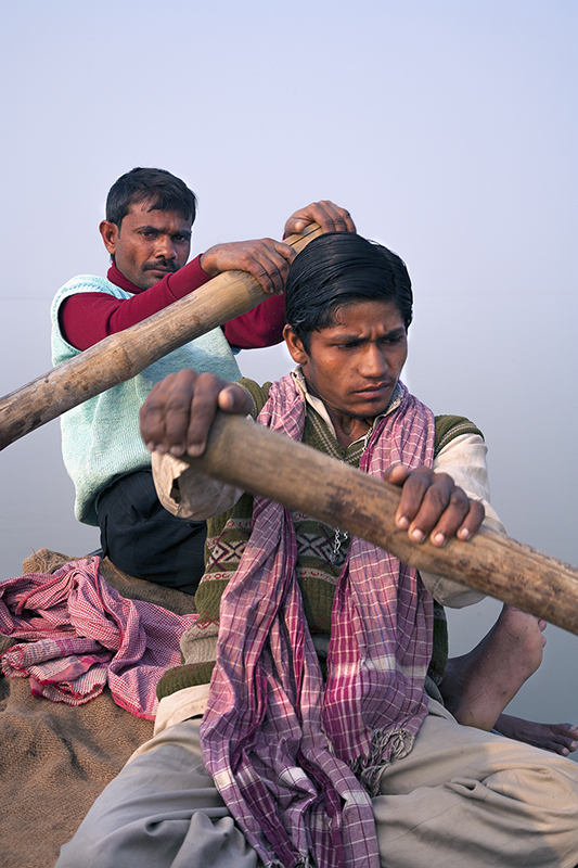 """Boatmen on Ganga Bhagalpur, Searching for endangered, bottlenose dolphins"" by Joan K. Sharma."