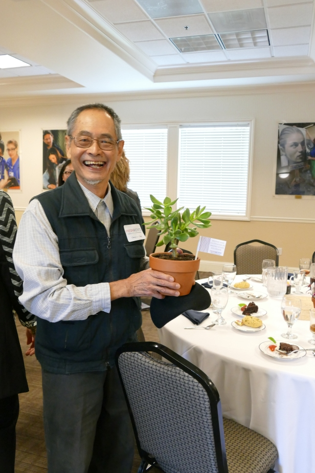 Dr. Cheng Lok Chua holds his new plant