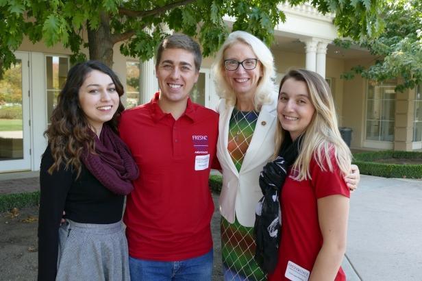 Students Marissa Mata, John Spankowski, and Tess Lopes-Medina pose for a photos with Associate Dean Honora Chapman.