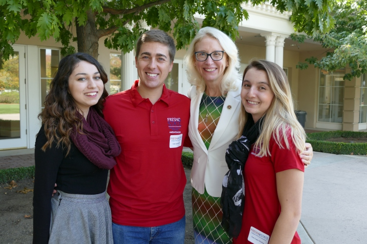 Students Marissa Mata, John Spankowski, and Tess Lopes-Medina pose for a photos with Associate Dean Honora Chapman.
