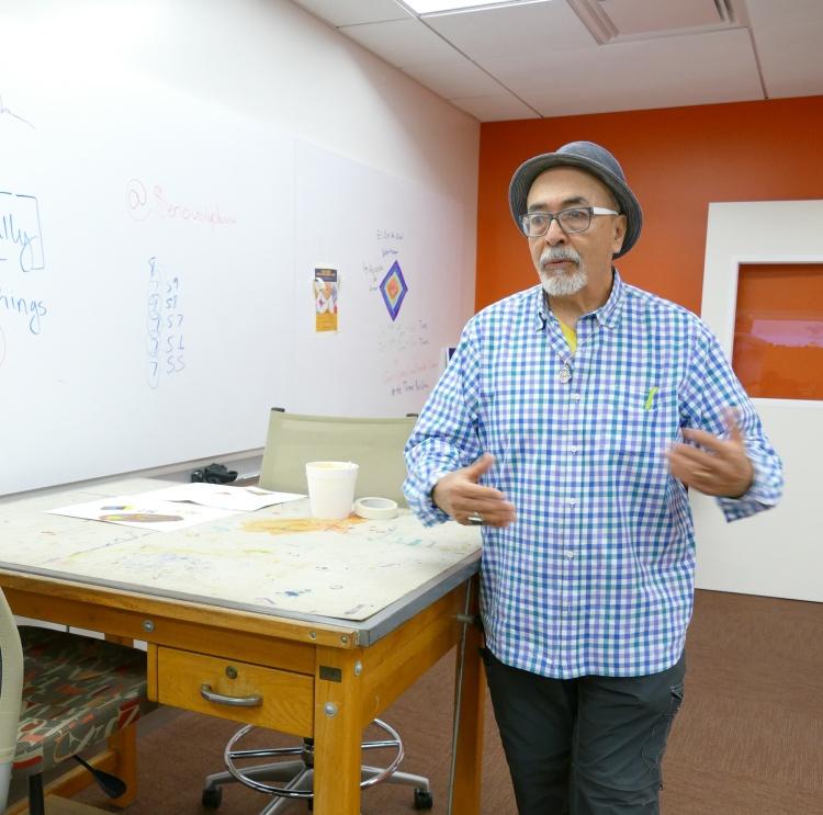 Juan Felipe Herrera talks about the old drafting tables used in the Laureate Lab.