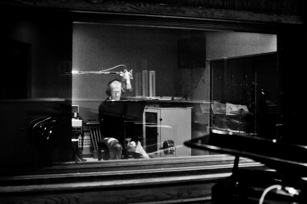 Philip Levine behind glass in the studio
