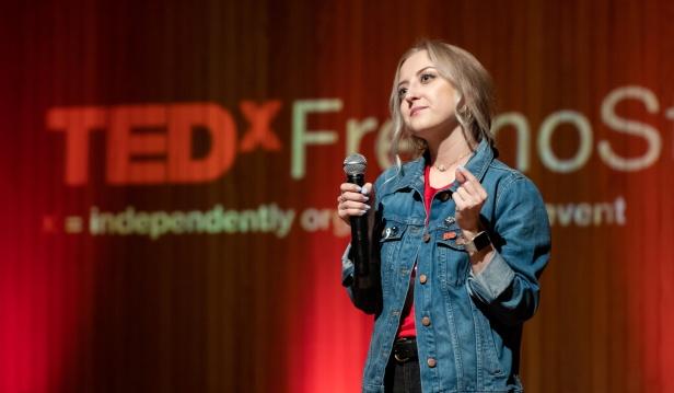Communication Student Sarah Kneeland delivers opening remarks at TEDxFresnoState
