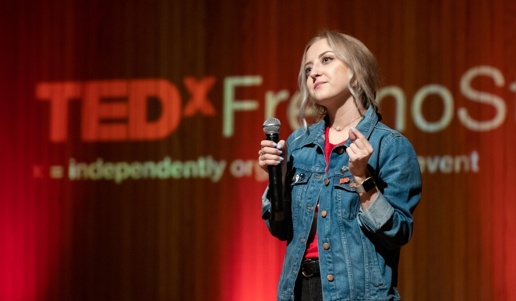 Communication Student Sarah Kneeland delivers opening remarks at TEDxFresnoState