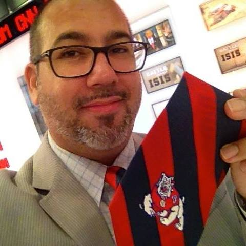 Victor Hernandez shows off his Fresno State Bulldogs tie at CNN.