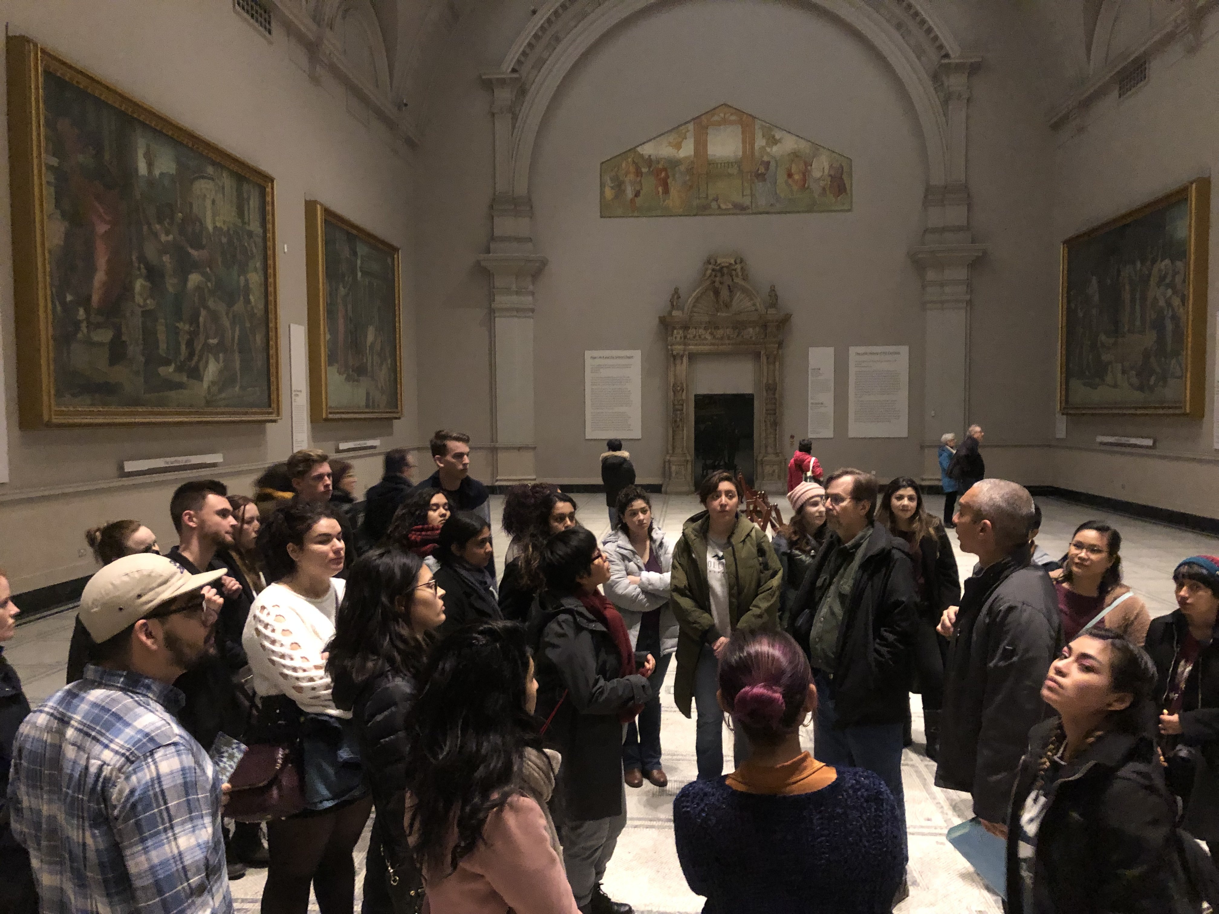 Professor Potter of the Art Department tells students about these paintings by Raphael at the Victoria and Albert Museum in London.