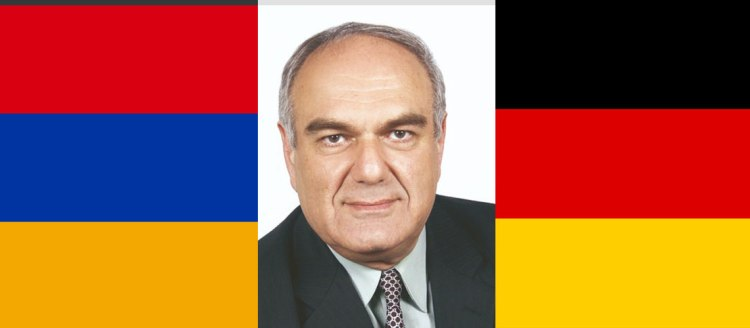 Dr. Levon Chookaszian with Armenia and Germany flags