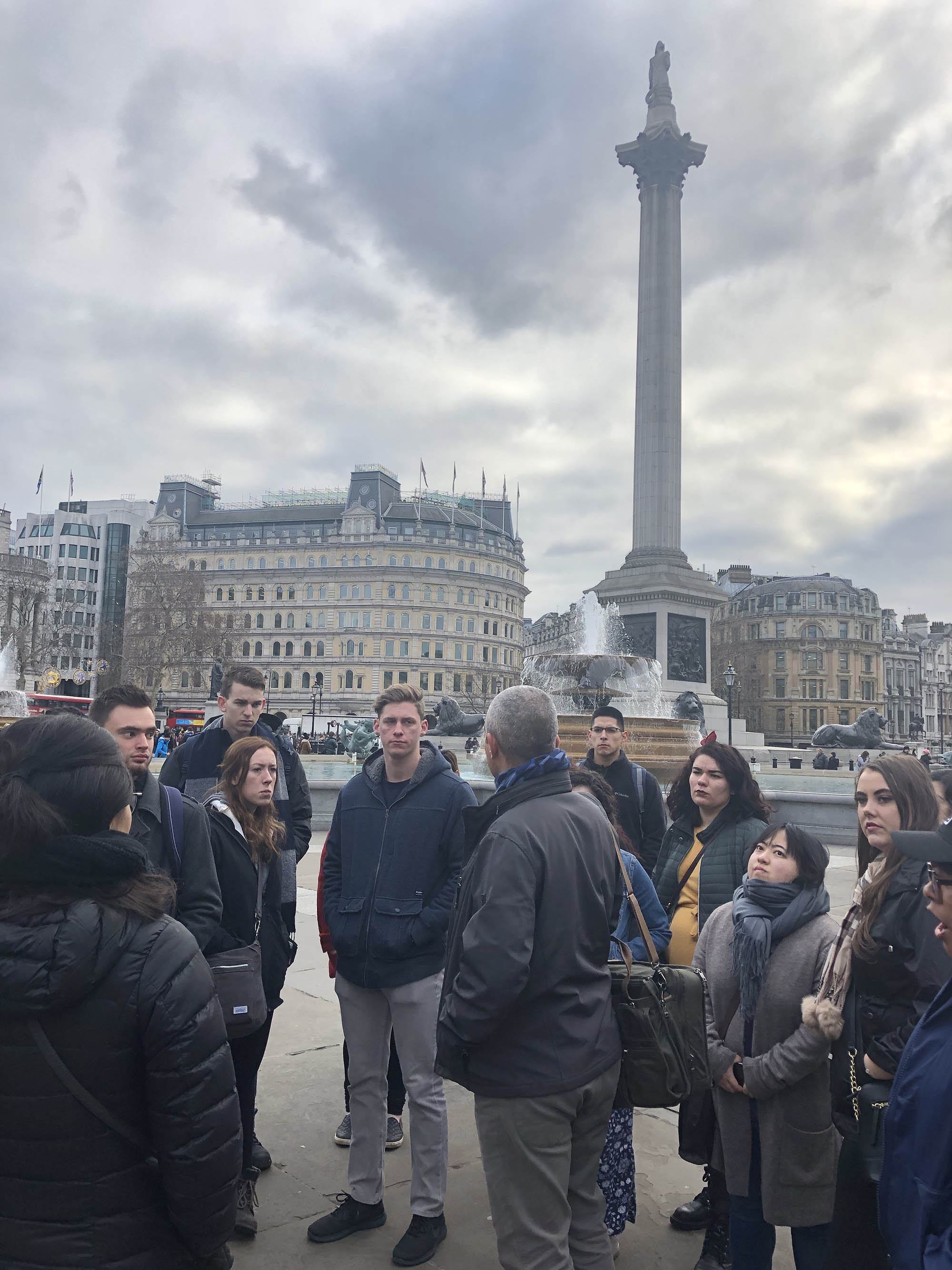 Professor Potter prepares students for what they will see in the National Gallery in Trafalgar Square below the Nelson Monument.