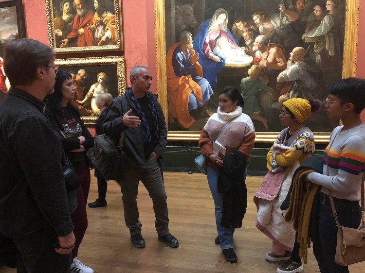 Professors Potter and Maldonado speak with students in the vast Italian Renaissance masters room.
