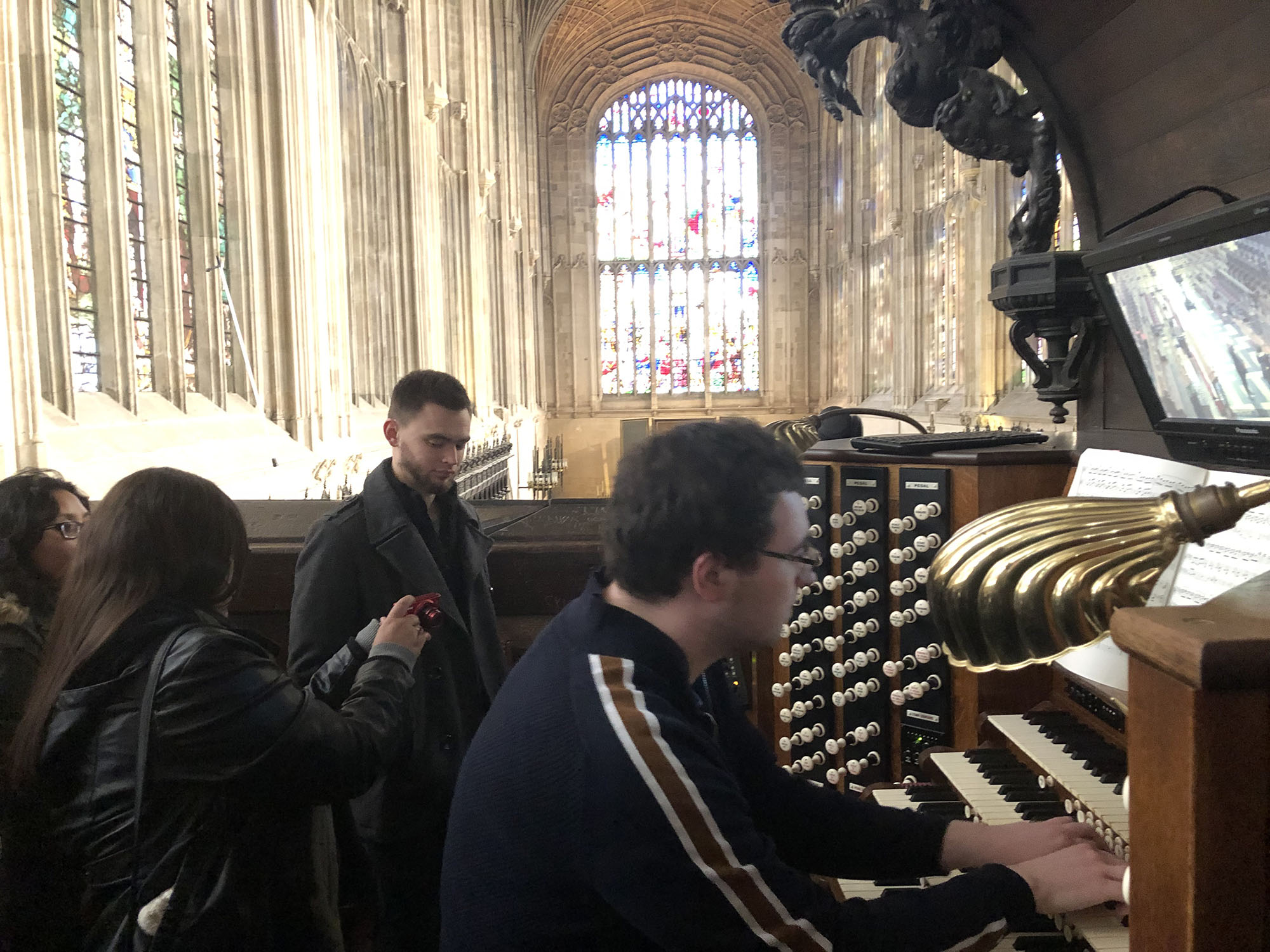 Students were invited up to the organ loft to hear the organ being played.
