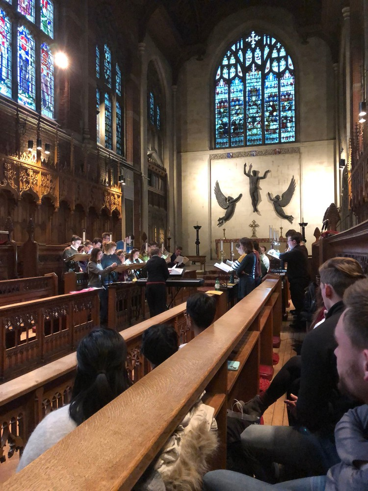 Fresno State students listen to the students of Selwyn College choir rehearse.