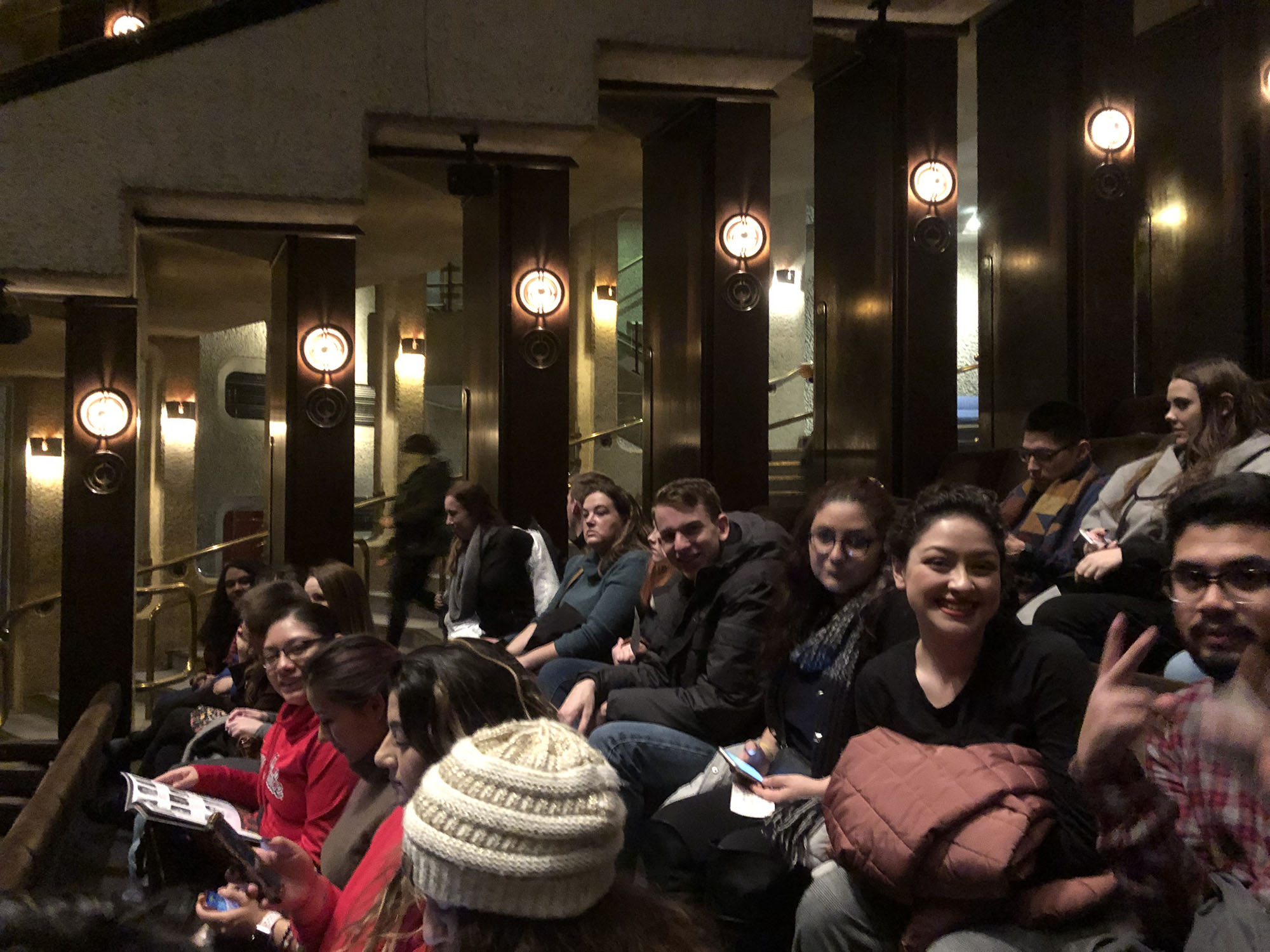 Students excitedly await the beginning of Macbeth at the Barbican Theatre.