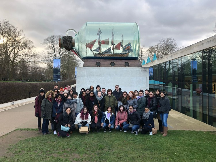 The class poses for a picture beneath Nelson's ship Endeavor in a bottle at the Maritime Museum in Greenwich.