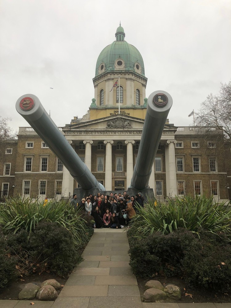 The class poses under the guns outside the Imperial War Museum January 12, 2019.