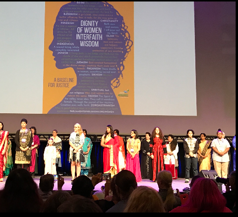 Kamesha Cornett on stage (lower right) at a Women's empowerment event