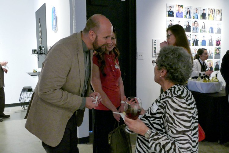 Mason Lamb talks with Arts and Humanities Advisory Board member Jacqueline Doumanian at the Arts in Motion reception.