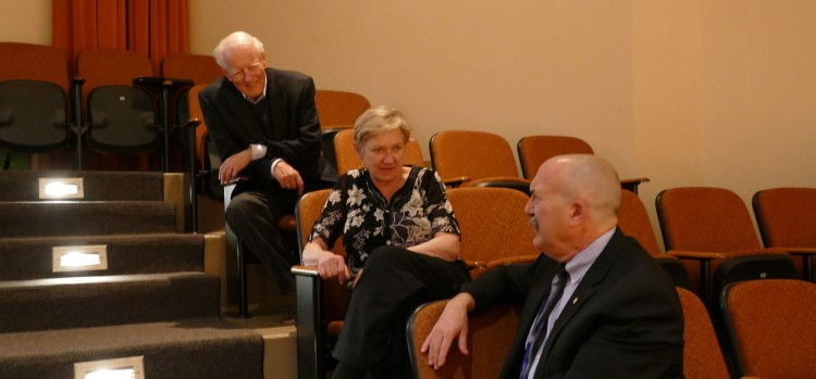 Dr. Gary P. Gilroy (right) talks with adjudicators Susan Hamre (center) and Dr. Thomas Lee (left) between performances.