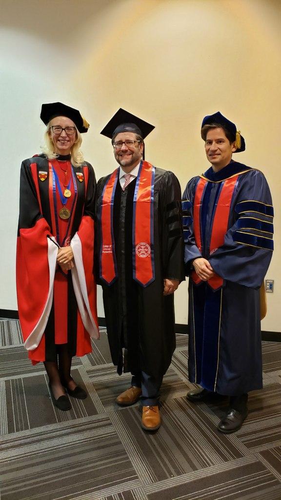 Associate Dean Honora Chapman (left) and Dean Saúl Jiménez-Sandoval (right) welcome National Endowment for the Humanities Chairman Jon Parrish Peede.