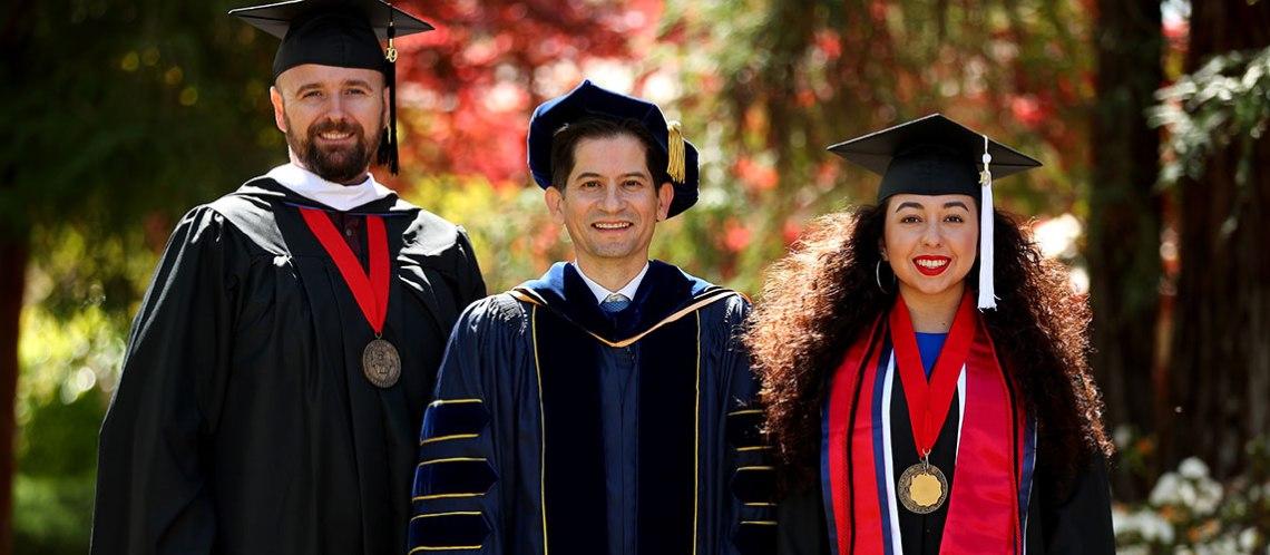 2019 Dean's Medalist Mason M. Lamb, M.A. and Primavera Leal Martinez, B.A. post with Dean Saúl Jiménez-Sandoval