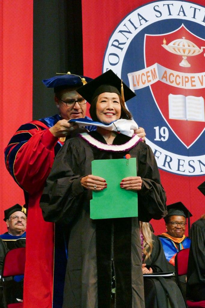 MCJ Alumna Janis Yanehiro receives an Honorary Doctorate of Humane Letters.