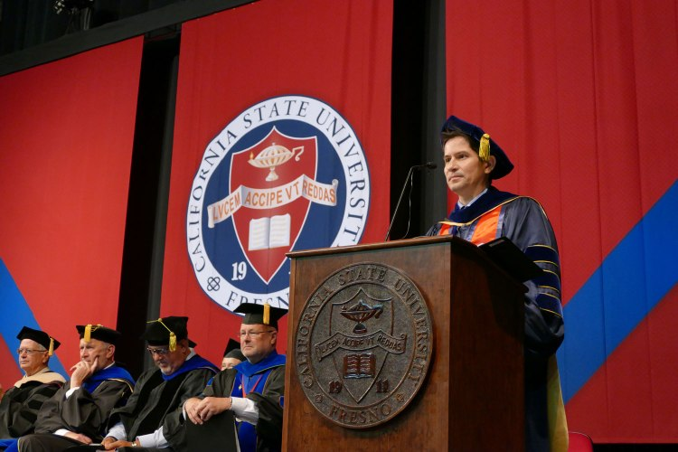 Dr. Saúl Jiménez-Sandoval acknowledges the College of Arts and Humanities graduates.