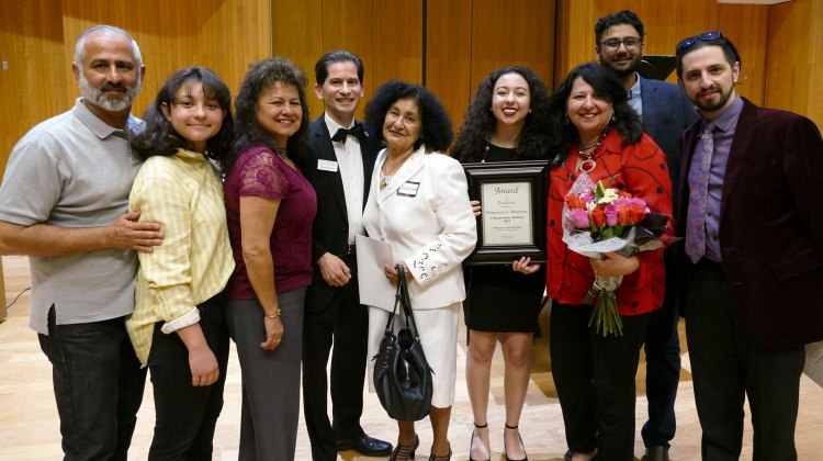 Dean's Medalist Primavera Leal Martinez with family, faculty and Dean Saúl Jiménez-Sandoval at the 2019 Arts in Motion event.