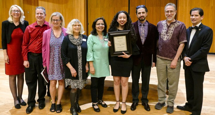 2019 Dean's Medalist Primavera Leal Martinez with College of Arts and Humanities faculty, administrators and board members at the Arts in Motion event.