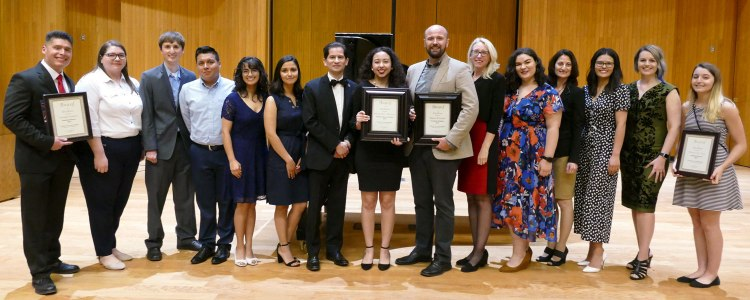 Dean Saúl Jiménez-Sandoval and Associate Dean Honora Chapman pose with the 2019 Dean's Medalist and Students of Distinction