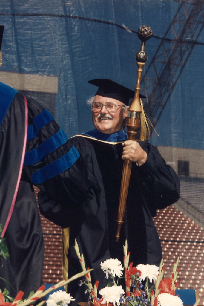 English Professor Emeritus Eugene Zumwalt, who is Chris Henson's husband, serves as grand marshal and mace-bearer of the University's 85th Commencement in 1996. (File photo: Chappell Studio)