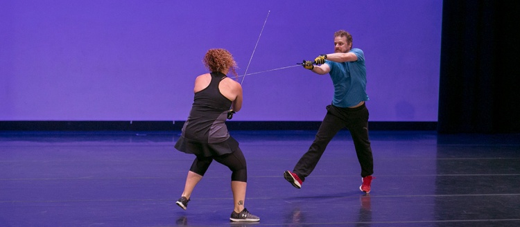 Artists present Shakespeare's work and include medieval broadswords during a Summer Arts Combat Presentation.