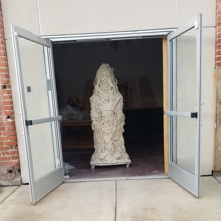 Sculpture in a doorway by Anabella Monzon