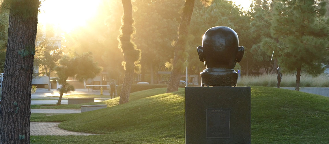 Gandhi's statue in the Fresno State Peace Garden at sunrise
