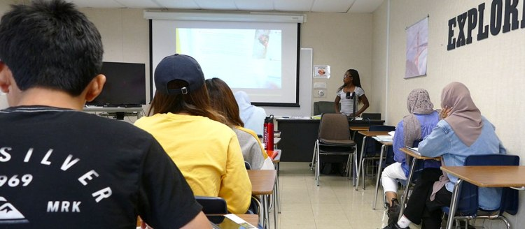Act Like a Teacher - Former Linguistics 171 student, Jeanette Yeboah-Amoako, teaches a class in her new job at the American English Institute.