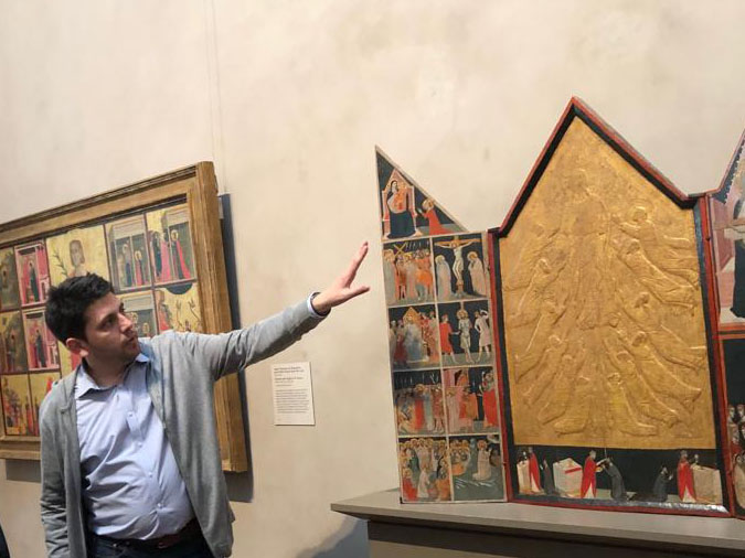 Dr. Gordo Peláez speaks in front of a piece at the Getty Museum in L.A.
