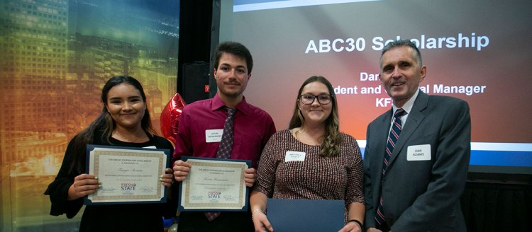 Recipients of the ABC30 Scholarship Tanya Acosta, Kevin Hernandez, and Brittney Steele with ABC30 President and General Manager Dan Adams.