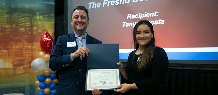 Fresno Bee Executive Editor Joe Kieta presents the Fresno Bee Scholarship to Tanya Acosta.